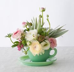 Pretty teacup flower arrangement.