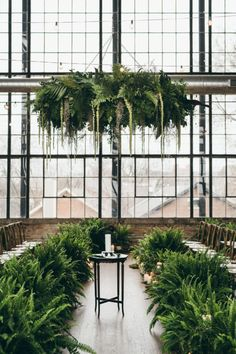 This earthy industrial wedding brought the garden inside! Photo: @edandaileenphotography