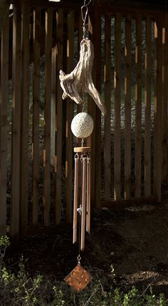 Pacific driftwood and beach stone wind chime: west coast garden.