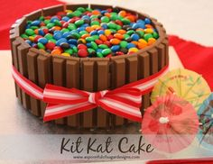 Kit Kat Birthday Cake - I made this the other day and it turned out DELISH as well as looking amazing!! I used 28cm cake pans I think and needed 4 family sized kit kats. The cake is so moist!! I'm going to keep recipe for normal chocolate cake too :) if making for an adult I would dissolve  a teaspoon of coffee in with the warm water I think that'd be yummy.