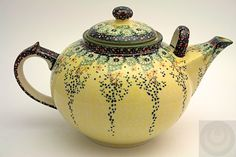 large Polish Pottery Sunshine Grotto pattern teapot ... floral decoration on light yellow. with loop on spout base to help lift and pour, c. 2010s, handpainted and sponge-stamped stoneware, Poland