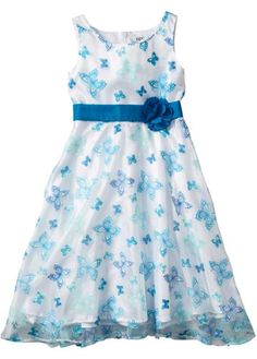 Se nu:Festlig klänning med vackert blomtryck och sött satinband med en fixerad blomma. Dragkedja baktill för enklare på- och avtagning. XXL-storlekar: bröst-/midjevidd +4 cm.