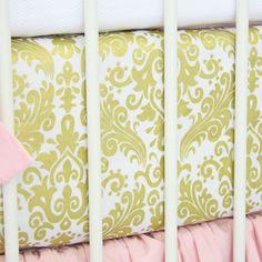 Caden Lane's Peggy's Pink and Gold Damask - A pink skirt with gold and white sheet is perfection in a pink and gold inspired nursery!