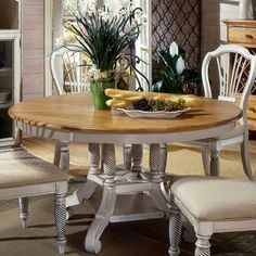 Crafted of New Zealand pine wood, this charming dining table showcases a hand-rubbed finish and turned pedestal base. Product: Dining... seats 6-8 people