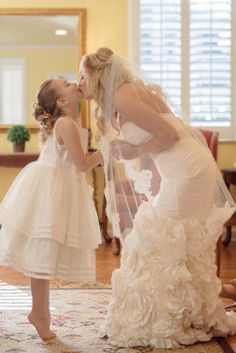 Flower Girl & Bride | Tina Sargeant Photography | http://www.theknot.com/submit-your-wedding/photo/36142d0a-cfeb-4908-aac1-0960316b9254/Spring-in-a-Winter-Park-FL-Wedding