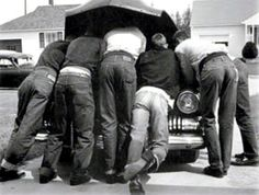 Reminds me of all of the old pics of my dad and his friends....always under a car hood. :)