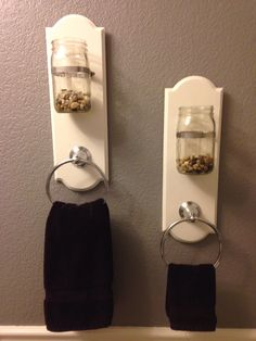 Mason jar sconce using hose clamps! Multipurpose with towel rings