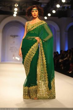 Sucheta Sharma walks the ramp for designer Adarsh Gill on Day 5 of the India Bridal Fashion Week (IBFW) 2013, held in New Delhi.