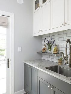 Laundry room cabinets give you more storage and style out of your washer-dryer space. Design smart laundry room cabinetry with our helpful tips. Laundry Room Cabinets, Grey Cabinets, Upper Cabinets, Laundry Rooms, White Cupboards, Laundry Area, Kitchen Redo, New Kitchen, Kitchen Dining
