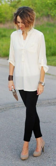 Ivory tunic blouse, black pants, nude heels and metallic clutch - a perfect date night look!