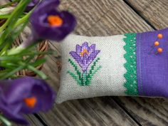 linen pincushion with hand  embroidered crocus by BelaStitches