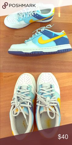 Nike dunks Light blue, navy, and yellow dunks. No noticeable wear on the exterior, some lint on the insides of souls. Great condition! Size 5Y Nike Shoes Sneakers