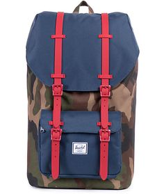 Throw all your things into a retro top-loading cinch main compartment that is secured by red rubber magnetic straps on a color blocked camo print and navy colorway.