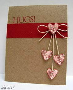 Sending Hugs Card by Lin.  Oh how the hearts dangle on this loving vertical card which makes it extra cute!  For a great 12x12 kraft cardstock for this project try Bazzill Basic's - in stock now at www.cardstockshop.com.