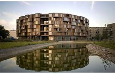 Designed by Lundgaard & Tranberg, Copenhagen's Tietgen Student Hall (Tietgenkollegiet) is a 288,000-square-foot, seven-story circular residential building outfitted with everything a college student would want, including a bike workshop, music rehearsal rooms and gourmet kitchens.