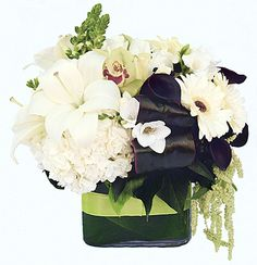 Black and white flower arrangement in a cube.