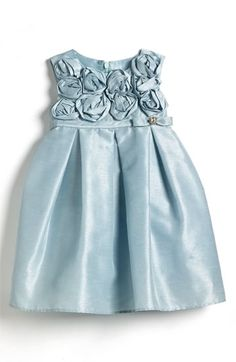 i dont ever put her in blue. this may be cute. I think I want something yellow, and all i find is pink! this with a big yellow flower headband?