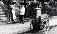 Pints please … delivering milk with a cart and urn in London in the early 20th century. Photograph: Popperfoto