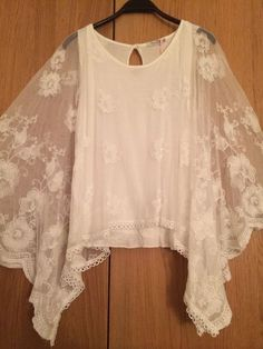 "Lagenlook DIY = Sheer white ""poncho"" draped over simple sleeveless shell - refashion a small, lace tabletopper into a poncho"