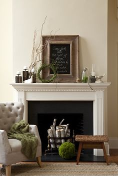 Love this mantel...chalk board, sticks