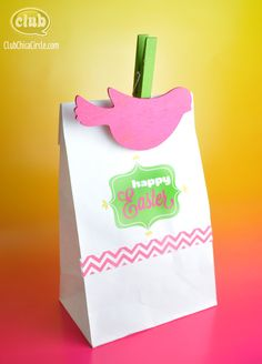 You can print on paper bags! With a little custom printer settings, you can run a paper bag through your printer. Get the free printable Happy Easter and other Spring designs. Simple and easy way to dress up a plain bag. Cute bird bag clips craft idea too.
