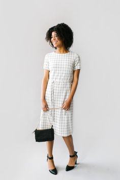 The 'Esther' dress is another one of our exclusive designs featuring a classic window-pane design. Made from a durable fabric and fully-lined with a belted waist for interest, this dress needs no laye