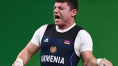 Olympic Weightlifter's Arm Snaps During Competition And The Pic Are Brutal
