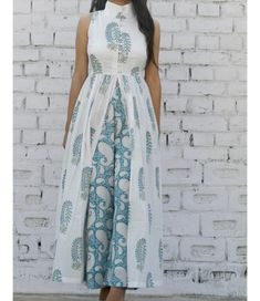 Mix N Match Cape and Pallazo Set – Alaya The Storehouse Shop online Turquoise and white set This set features a sleeveless buttoned down cape with detailing on the neck. It is paired with block printed flared pants with a contrast print pattern a stunni