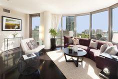 bedroom with dark hardwood floors | ... living room of your signature 2 bedroom residence at The Metropolitan
