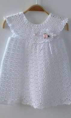 Dreamlike and romantic christening gown crocheted by hand from pure fine cotton. On the dress is a beautiful Boutonnière (crocheted plug-in flower) attached. Crochet Dress Girl, Crochet Baby Dress Pattern, Baby Girl Crochet, Crochet Baby Clothes, Baby Knitting Patterns, Hand Crochet, Knit Dress, Crochet Patterns, Kids Crochet