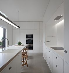 actually a beautiful kitchen - pretty cool. is the floor concrete? C/Z House by SAMI arquitectos
