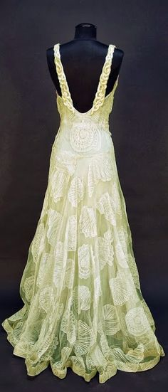 House of Worth (back) c1932. Sleeveless pale seafoam green V-neck decorated with large shells of various types. Belonged to Elizabeth Arden.