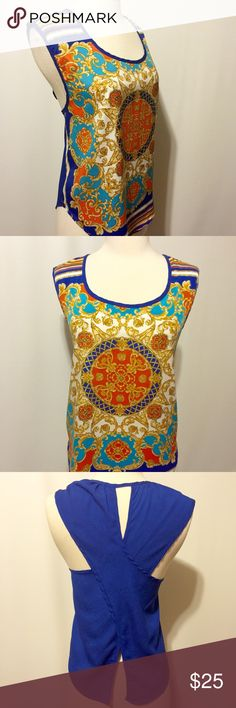 "Royal Blue Flyaway Back Statement Blouse Wow!!! Amazing colors and details. Royal, orange, turquoise and white medallion print with stripe accents. Open back. Neckline and armhole framed in royal. 100% poly Hand  wash 40"" bust 24"" overall length Tops Blouses"
