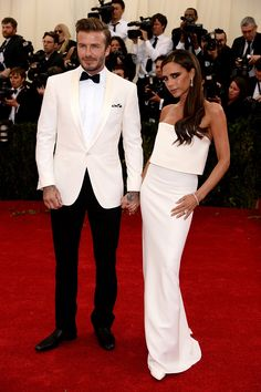 David Beckham in a Ralph Lauren Black Label suit and Christian Louboutin shoes and Victoria Beckham in Victoria Beckham at the 2014 Met Gala. See more on Vogue.com.