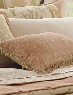 Freshen any décor with the Corsica Decorative Throw Pillow with Beaded Trim that features warm, soft hues of coral pink and mossy green.