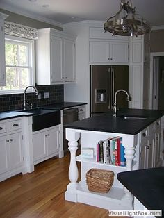 Black soapstone counter kitchen white cabinets - love this sink