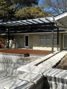 lueders limestone pool coping with ipe deck and polygal shade