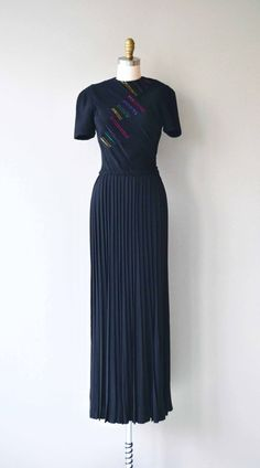 Vintage 1930s black rayon full length dress with micro-pleated bodice, short sleeves, red, green, blue and gold beading, fitted waist, long pleated skirt and metal side zipper. Also a short metal zipper at the nape of the neck. --- M E A S U R E M E N T S ---  fits like: xs shoulder: 14 bust: 32-34 waist: 24-25 hip: up to 42 length: 61 brand/maker: n/a condition: excellent  ✩ layaway is available for this item  To ensure a good fit, please read the sizing guide: http://www...