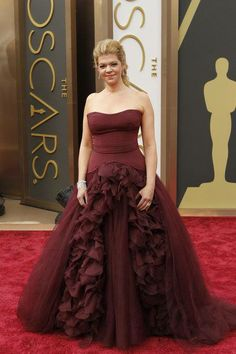 From the Oscars - not only a dreadful color, but THIS dreadful gown with the lace all pouffed out on the bottom looks rather like she's opening her privates to the public - EWWWW. NOT a look for the Oscars - or anywhere.
