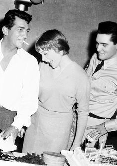 "elvis and shirley maclaine celebrating martin's birthday on the set of the film ""all in a night's work"", june 7, 1960."