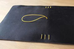 Putting the elastic bands in the leather cover