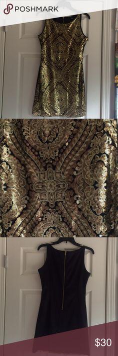 Gold Sequin Mini Gorgeous gold sequins pattern front with plain black zippered back tank dress. XOXO Dresses Mini