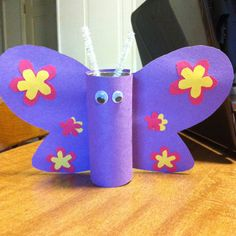 butterfly! used a toilet paper roll, cardboard, eyes and pipe cleaner!