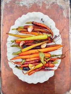 Jamie Oliver's carrot side dish with thyme, caramelised garlic, clementine & honey