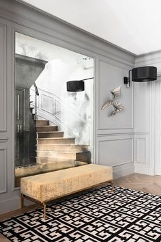 Even though the moulding adds a bit of detail, since it is painted the same neutral grey of the walls, the stairs and perfectly matching bench are what catch your eye. Home Room Design, Home Interior Design, House Design, Home Modern, Modern Entryway, Apartment Makeover, Classic Interior, Luxurious Bedrooms, Living Room Decor