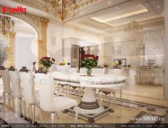 Màu sắc nhã nhặn, trang trí thêm những bình hoa làm tăng thêm sự quyến rũ và kiều diễm cho không gian phòng ăn kiến trúc Pháp