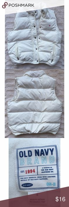 Old navy white puffy vest Machine wash cold. Great condition. Keeps you warm. Lightly used Old Navy Jackets & Coats Vests