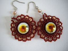 This is an elegant pair of earrings. I have used toho seed beads 11/0, 15/0 darkest red. I have also used 3mm copper crystal faceted firepolish. The