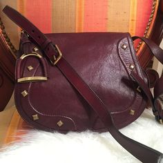 🎄Classic Americana burgundy leather crossbody This is a phenomenal item to own. Purchased at Ralph Lauren boutique in Palm Beach, Florida 2 years ago. In great condition. It features western brass studs and details and a horse bit side attachment.   ❤️ Love the item but not the price, send me an offer using the offer button!  ✔️ Bundle 3+ items, get 20% off 🚫 No Trades, PayPal, or Negotiating in the comments. Ralph Lauren Bags Shoulder Bags
