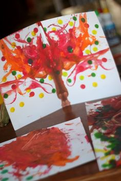 Make a fall tree painting by pulling strings